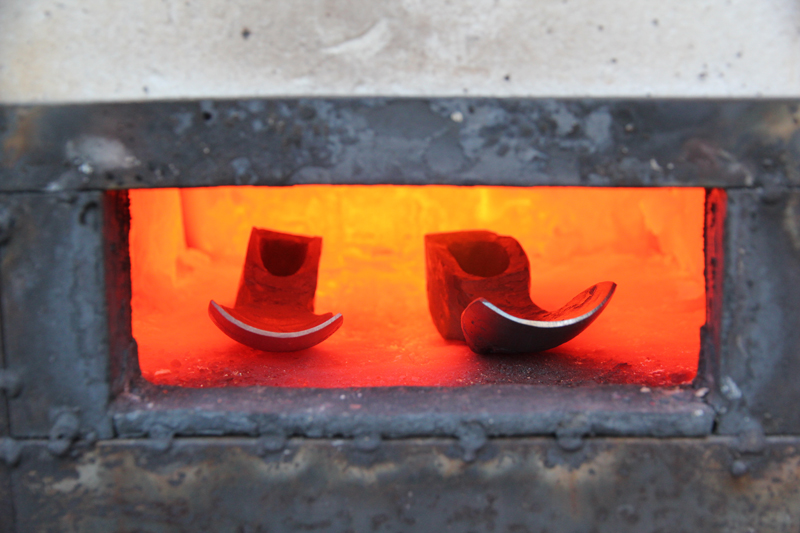 Adzes heating in the gas forge.